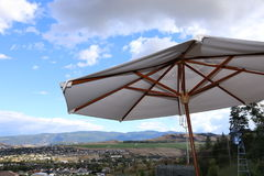 Luxury patio Umbrella`s- lake resort travel. When you travel to Luxury resorts you will find many summer patios with great views off a hotel deck or restaurant Stock Images