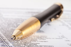 Luxury pen. Financial report with circled numbers and luxury pen on it Royalty Free Stock Photos