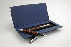 Luxury pen set. Luxury business pens in a opened blue case Stock Photography
