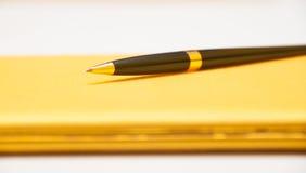 Luxury pen on yellow contract Stock Photography