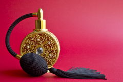 Luxury perfume bottle. A close-up shot of a gold luxury perfume bottle Royalty Free Stock Photography