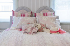 Luxury pink color scheme bedroom with bag and hat on bed Stock Image