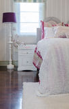 Luxury pink color scheme bedroom with white table and lamp Royalty Free Stock Photography