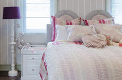 Luxury pink color scheme bedroom with white table and lamp Stock Images