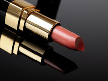 Luxury pink lipstick on black background. make-up Stock Images
