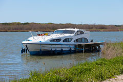 Luxury pleasure boat moored at the pier Royalty Free Stock Images