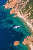 Luxury pleasure yacht anchored near beach Royalty Free Stock Image