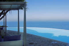 Luxury pool. With a sea view royalty free stock photography