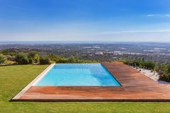 Luxury pool on a background of beautiful scenery. Royalty Free Stock Image