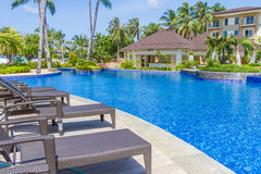 Luxury pool in a hotel, resort leisure time,. Relaxing near the pool Stock Photography