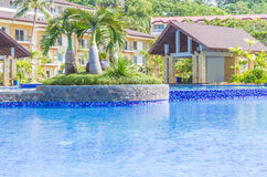 Luxury pool in a hotel, resort leisure time, Royalty Free Stock Images