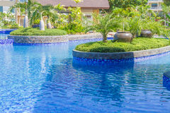 Luxury pool in a hotel, resort leisure time, Royalty Free Stock Image