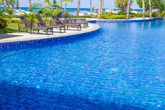 Luxury pool in a hotel, resort leisure time, relaxing near the p Royalty Free Stock Image