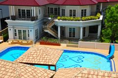 Luxury pool house Royalty Free Stock Images