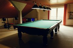 Luxury pool table at recreation room in rehabilitation centre in Royalty Free Stock Photography