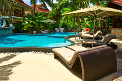 Luxury poolside area Stock Photography