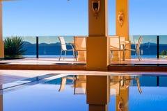 Luxury poolside dining Stock Image