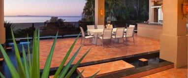 Luxury poolside dining Stock Photo