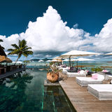 Luxury poolside jetty Stock Images