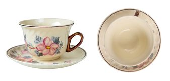 Luxury porcelain vintage tea cups with beautiful floral design. In top and side view. Design elements isolated on white background. Isolation is on a Royalty Free Stock Image