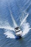 Luxury Power Boat Yacht on Blue Sea. Aerial photograph of luxury power boat yacht speedboat on blue sea stock photos