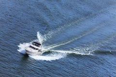 Luxury Power Boat Yacht on Blue Sea. Aerial photograph of luxury power boat yacht speedboat on blue sea royalty free stock photo