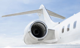 Luxury private aircraft - Bombardier Global Express. Jet Engine with a tail and part of a wing on a luxury private Jet Plane - Bombardier Global Express stock photos