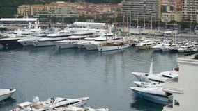Luxury private boats docked in harbor, prestigious yacht club in Monaco, wealth stock video