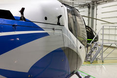Luxury private helicopter parked in the hangar. Stock Images