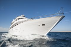 Luxury private motor yacht sailing at sea Royalty Free Stock Photos
