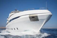 Luxury private motor yacht sailing at sea Stock Photo
