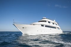 Luxury private motor yacht sailing at sea Royalty Free Stock Photo