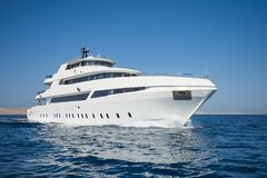 Luxury private motor yacht sailing at sea Stock Image