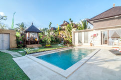 Luxury and Private villa with pool outdoor. Exterior luxury villa in Bali with a garden, gazebo and swimming pool outdoors royalty free stock photography