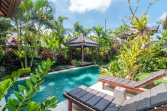 Luxury and Private villa with pool outdoor. Exterior luxury villa in Bali with a garden and swimming pool outdoors stock photos