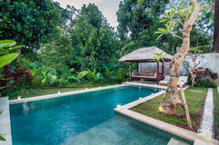 Luxury and Private villa with pool outdoor. Exterior luxury villa in Bali with a garden and swimming pool outdoors stock photo