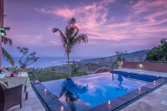 Luxury and Private villa with pool outdoor. Exterior luxury villa in Bali with a garden and swimming pool outdoors royalty free stock image