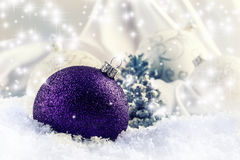 Luxury purple Christmas ball with ornaments in Christmas Snowy Landscape. Royalty Free Stock Images