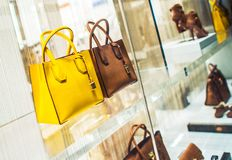 Luxury Purses Shopping. Luxury Purses and Shoes Shopping. Luxury Goods Concept Photo. Store Display Stock Images