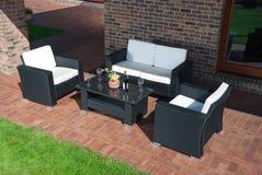Luxury rattan Garden furniture. Luxury Garden rattan furniture at the patio Royalty Free Stock Photo
