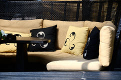 Luxury rattan sofa with scatter cushions Royalty Free Stock Images