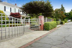 Luxury real estate in Tacoma, WA. House with large entrance gate Royalty Free Stock Photography