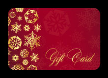 Luxury red gift card with golden snowflakes Royalty Free Stock Photos