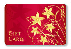 Luxury red gift card with golden swirls and flower Royalty Free Stock Image