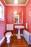 Luxury red and gold small bathroom Royalty Free Stock Image