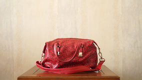 Luxury Red Hand Bag On a Table Royalty Free Stock Photography