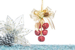 Luxury red jingle Bells, flower and Pine Cone with Snow Royalty Free Stock Images