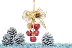 Luxury red jingle Bells and Pine Cone with Snow Stock Image