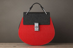 Luxury Red Leather Women Bags. 3d Rendering. Luxury Red Leather Women Bags on a wooden table. 3d Rendering Stock Image