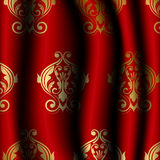 Luxury red material with gold pattern Royalty Free Stock Photo